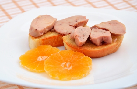 cod liver: Cod liver with tangerines.