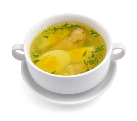 chicken soup: Chicken broth with egg and greens. Isolated on white background.