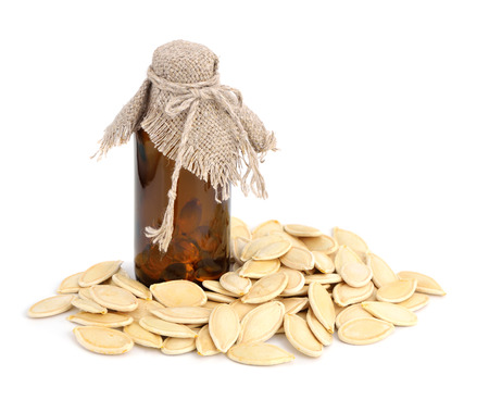 gourds: Pumpkin seeds oil. Isolated on white background. Stock Photo