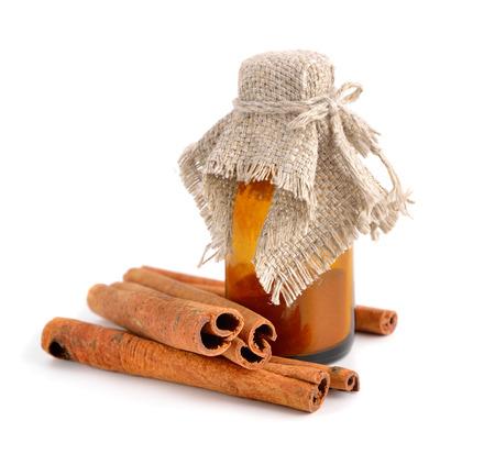 whitw: Bark of cinnamon and pharmaceutical bottle. Isolated on whitw background. Stock Photo