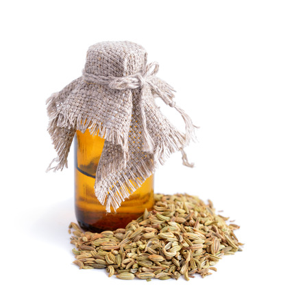 fennel seeds: Fennel seeds with essetial oil.  Isolated. Stock Photo