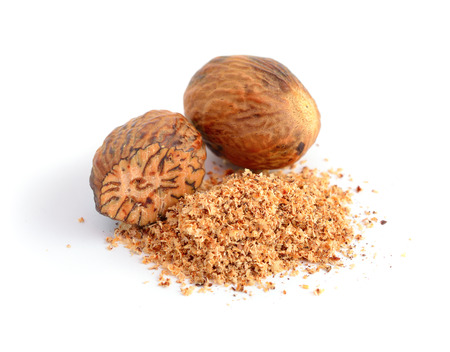 Nutmeg with shavings. Isolated on white.