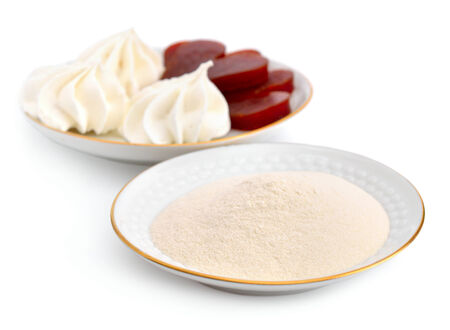 pectin: Agar-agar powder on a white plate  On a background Zefir and fruit jelly  Isolated