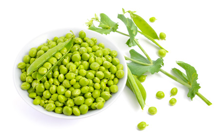 Pea on white plate isolated photo