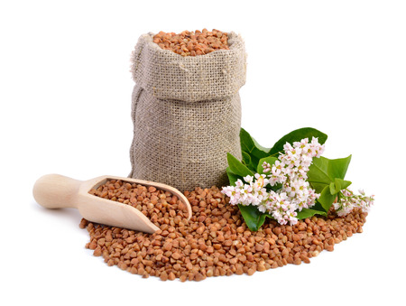 Buckwheat bag and flowers isolated  photo