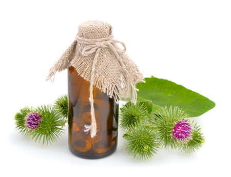 burdock: Burdock with pharmaceutical bottle isolated on white background Stock Photo