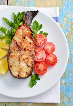 cooked fish: Fish grill on white plate