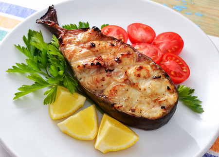 Fish grill on white plate photo