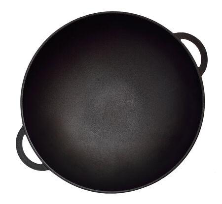 Empty iron wok. Isolated on white background.
