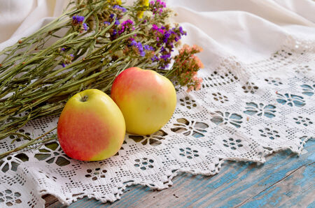 Still life with Limonium and apples photo