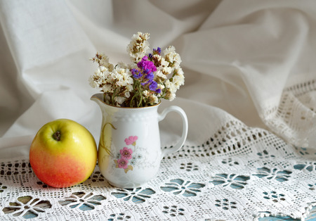 Still life with Limonium and apple photo