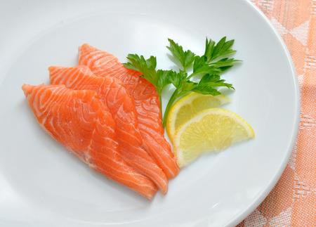 dog salmon: Salmon on white plate
