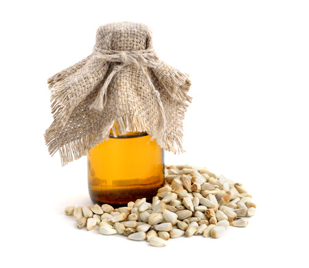 Safflower seeds oil isolated. Standard-Bild