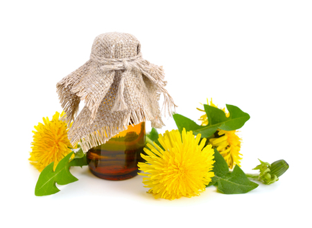 pharmaceutical bottle: Dandelion flowers with pharmaceutical bottle. Isolated on white background. Stock Photo