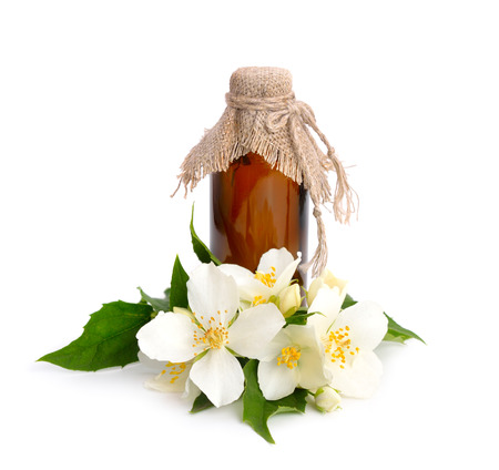 pharmaceutical bottle: Flowers of a jasmine and pharmaceutical bottle. Isolated.