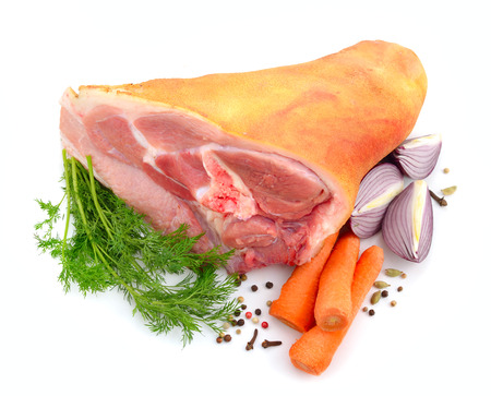 meat alternatives: Raw Eisbein or ham hock, or Schweinshaxe with wegetables. Isolated on white background.