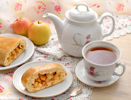 cake plate: Still life with apple pie and tea.