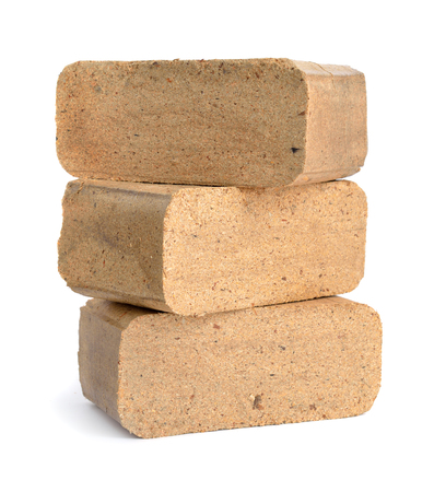 briquettes: Biomass briquettes are a biofuel substitute to coal and charcoal. Isolated on white background. Stock Photo