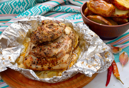 meat and alternatives: Baked pork on round board. Stock Photo