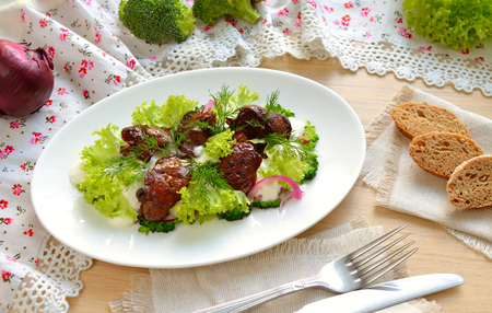 servings: Salad with a chicken liver and broccoli Stock Photo