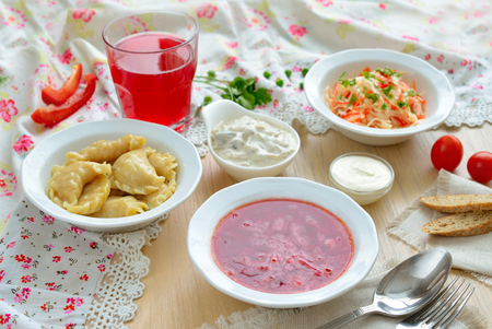 Borsch and vareniki. Traditional Ukrainian lunch. Stock Photo