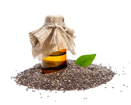 Chia seed with pharmaceutical bottle. Isolated on white background.