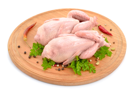 meat alternatives: Quail meat on the round board. Isolated on white background.