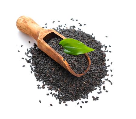 Black sesame seeds. Isolated on white background. Stockfoto