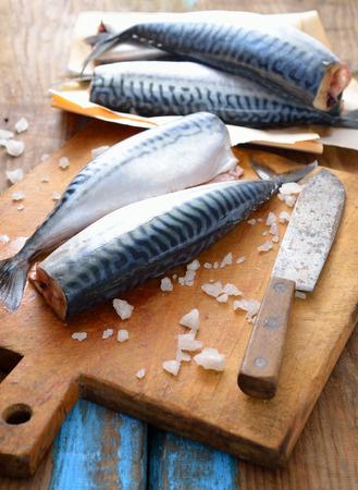 fish vendor: Fresh mackerel on the board. Stock Photo