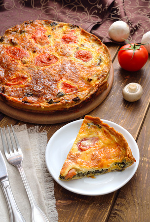 pastry crust: Quiche is a savoury, open-faced pastry crust with a filling of savoury custard with cheese, Spinach and mushrooms.