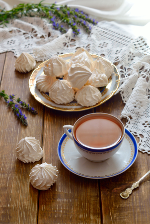 A bowl of home-made meringues with tea.