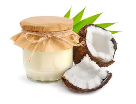 spa therapy: Jar of coconut oil and fresh coconuts isolated