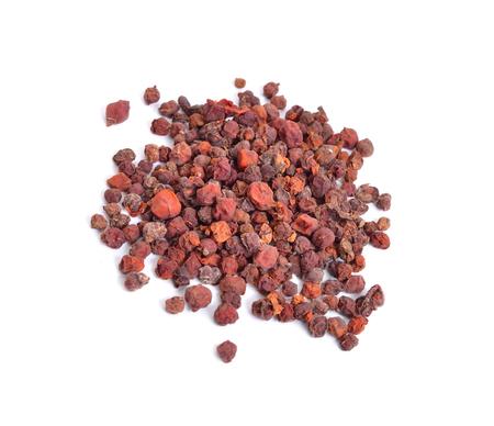 Schisandra chinensis, magnolia-vine, Chinese magnolia-vine, schisandra, magnolia berry, five-flavor-fruit,  wu wei zi. Dried fruit isolated. Archivio Fotografico