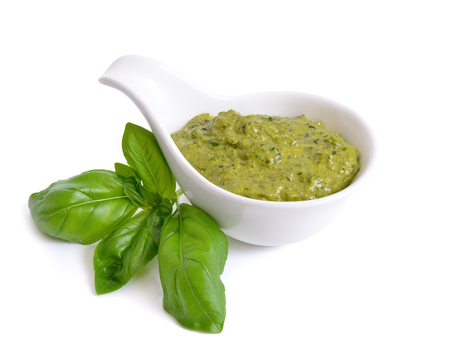 Pesto sauce in a bowl. Isolated On white. Stock Photo