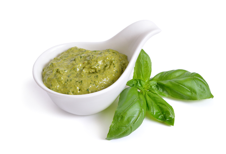 Pesto sauce in a bowl. Isolated On white. Archivio Fotografico
