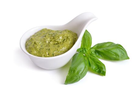Pesto sauce in a bowl. Isolated On white. Stockfoto