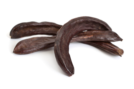 Carob pods isolated on white background.