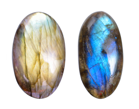 Two Polished blue labradorite Caboshons. Isolated on white background.