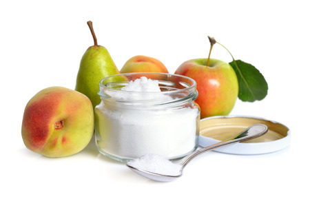Fructose, or fruit sugar in glass jar. With fruit. Isolated. Reklamní fotografie