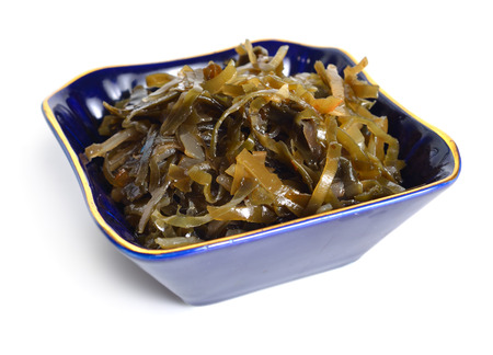Pickled kelp isolated on white background