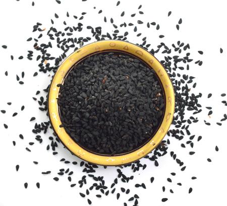 Seed of Nigella sativa or fennel flower, nutmeg flower, black caraway, Roman coriander, black cumin, blackseed, black caraway, Bunium persicum. Isolated.