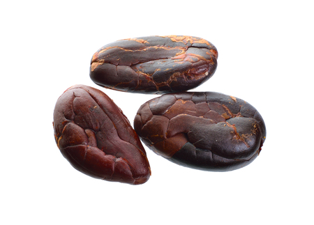 Roasted cocoa beans isolated on white background. Full dept of field.