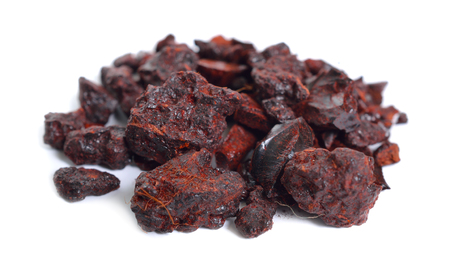 Dragon's blood is a bright red resin that is obtained from different species of a number of distinct plant genera: Croton, Dracaena, Daemonorops, Calamus rotang and Pterocarpus. Isolated.