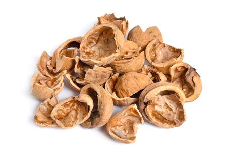 Walnut shells bunch isolated on white background Imagens