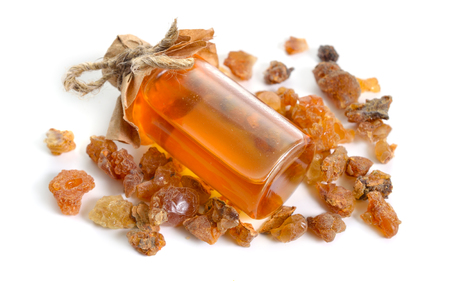 Myrrh is a natural gum or resin extracted from a number of small, thorny tree species of the genus Commiphora Isolated on white, Stok Fotoğraf