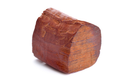 Chandan or red sandalwood piece isolated on white baclground.