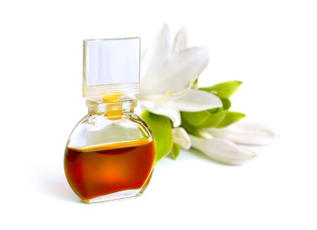 Agave amica or tuberose essential oil in perfume bottle isolated on white background.