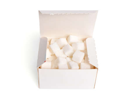 Heap of Sugar cubes on the box isolated on white background Standard-Bild