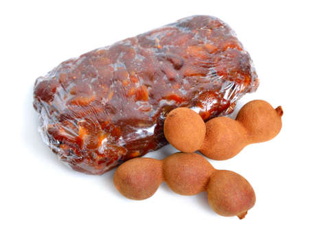 Briquette of ripe Peeled tamarind isolated on white baclground Standard-Bild