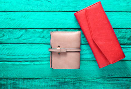 Female purse on a turquoise wood background. Fashionable women's accessories. Top view.